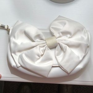 Ivory purse with bow.